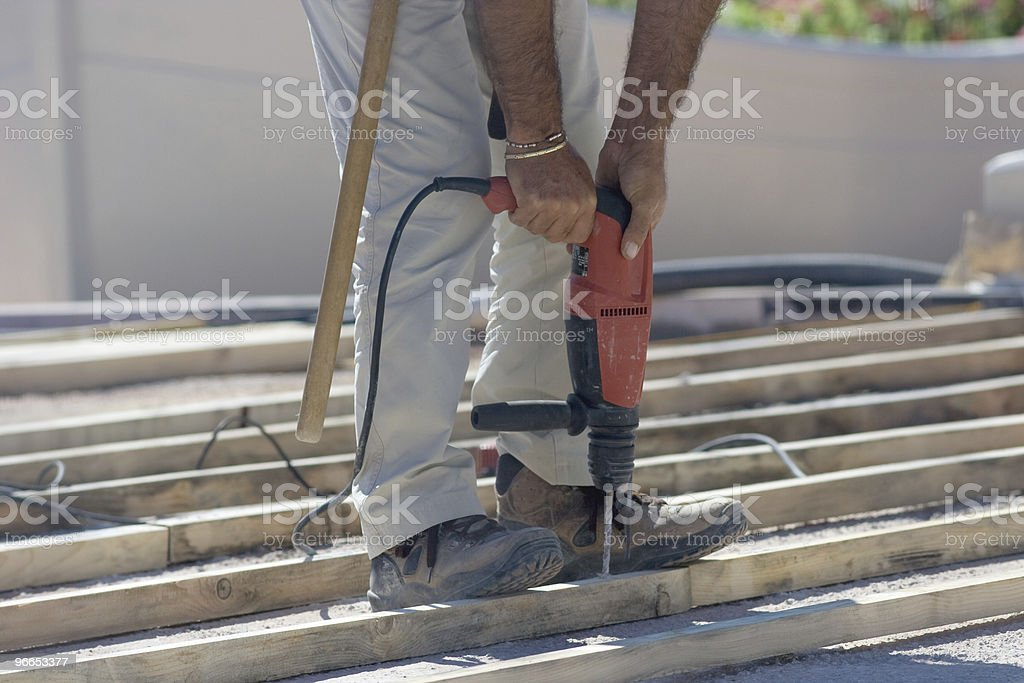 Carpenter Working On Stairs royalty-free stock photo