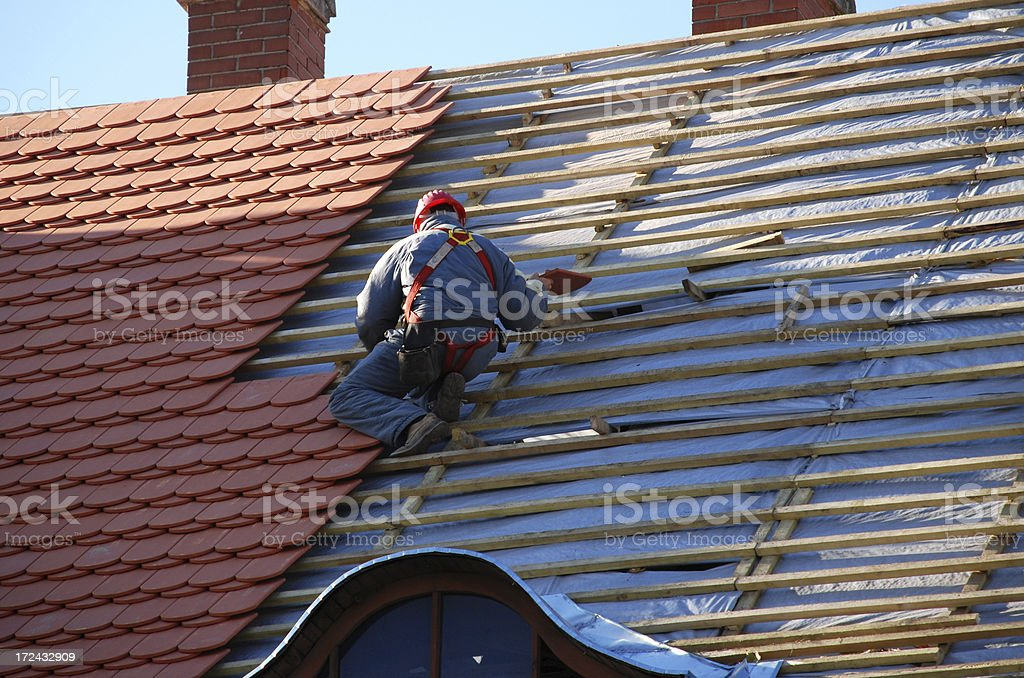 carpenter working on the roof stock photo