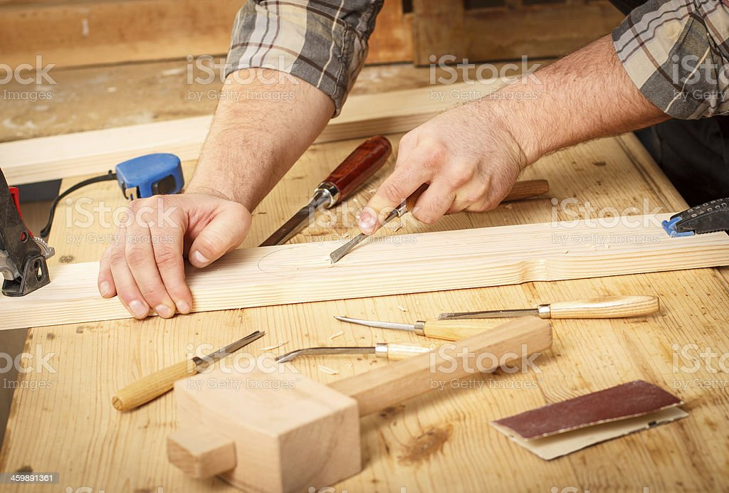 Carpenter working with tools. stock photo