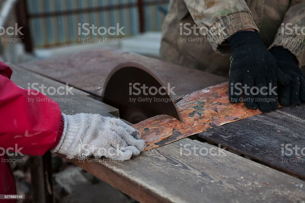 carpenter  works on woodworking the machine tool stock photo