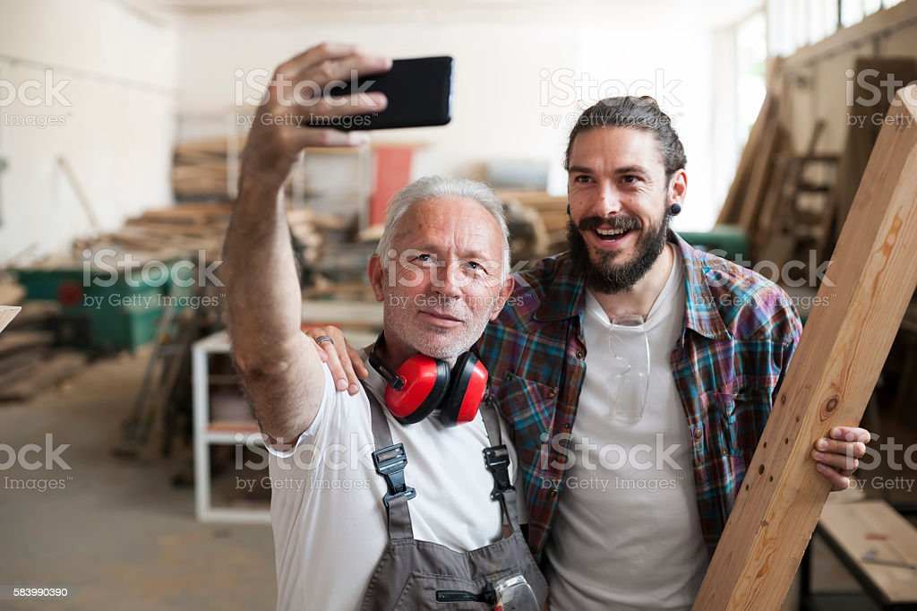 Carpenter's at work making selfie stock photo