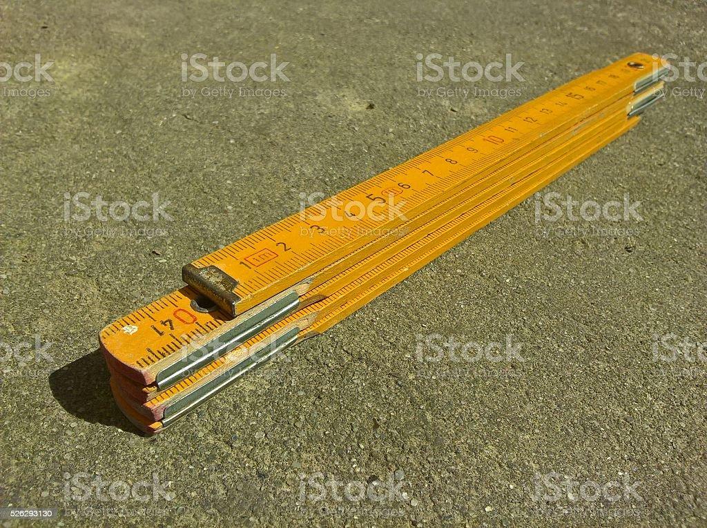 Carpenter's Folding Ruler (Yellow) stock photo