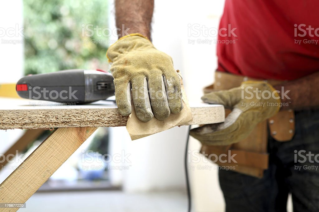 Carpenters hands stock photo