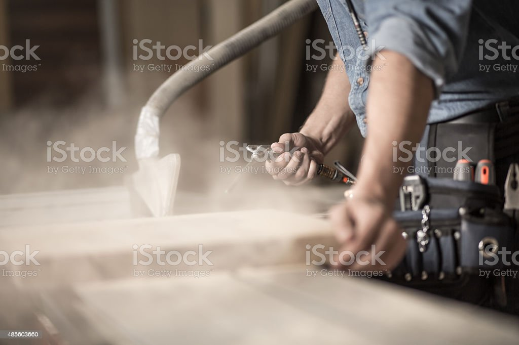 Carpenter's hands working with wood stock photo