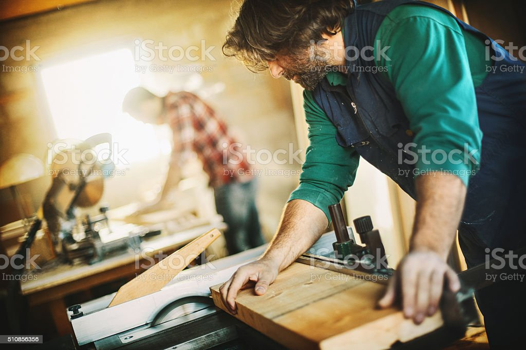 Carpenters making furniture. stock photo