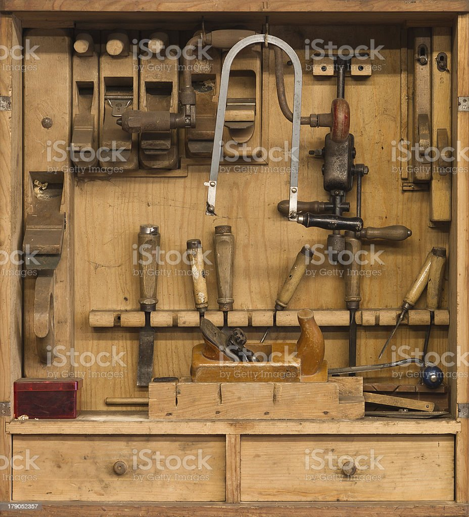 carpenters tools in a wooden cabinet royalty-free stock photo
