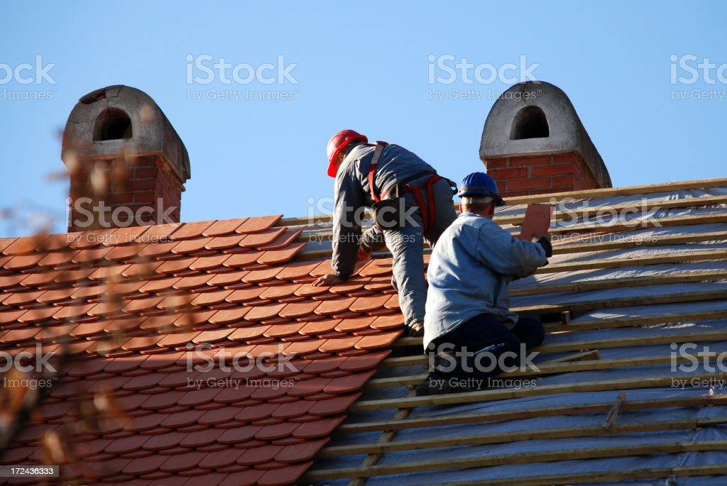 carpenters working on the roof stock photo