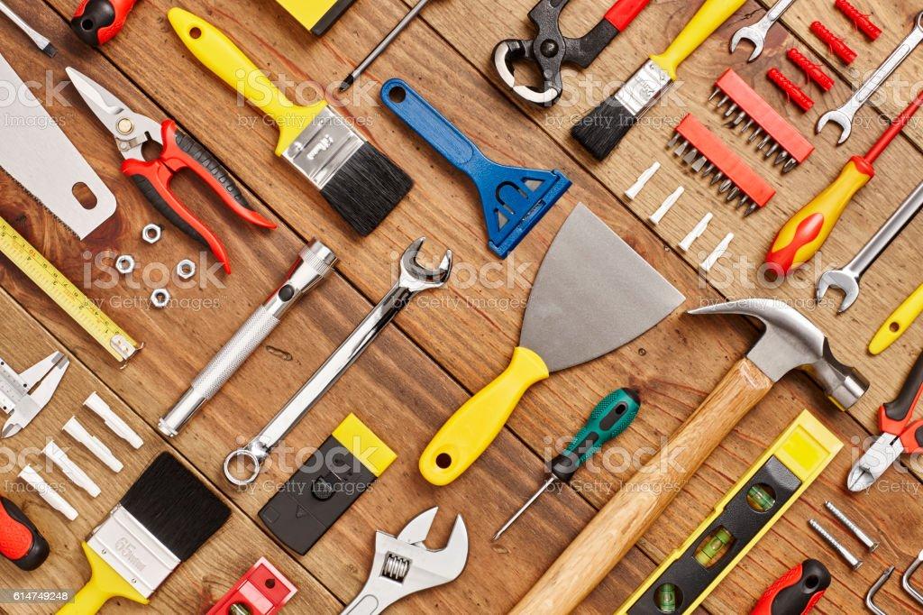 Carpentry tools arranged diagonally on wood - Knolling stock photo