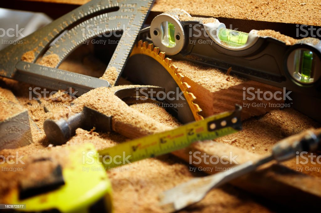 Carpentry Tools Covered in Sawdust stock photo