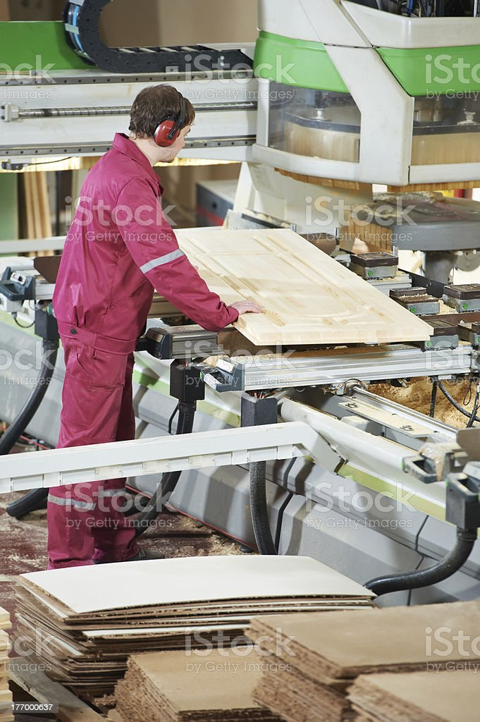 carpentry wood cross cutting stock photo