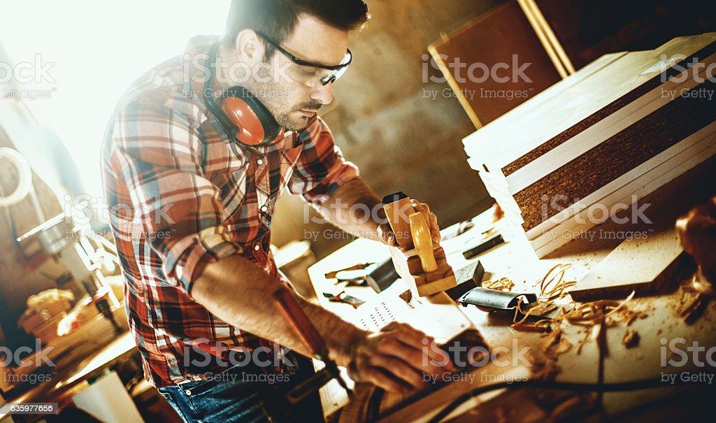 Carpentry workshop routine. stock photo
