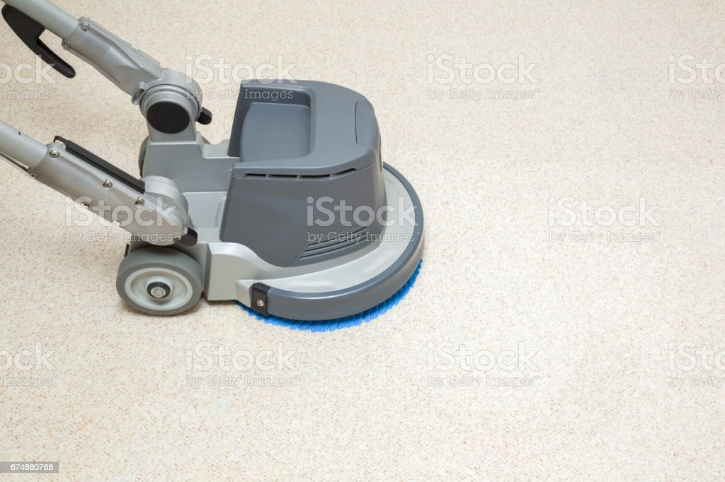 Carpet chemical cleaning with professionally disk machine. Early spring cleaning or regular clean up. stock photo