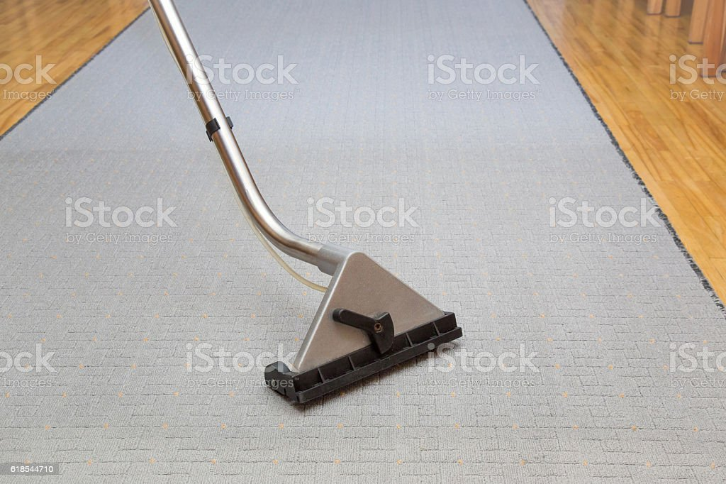 Carpet chemical cleaning with professionally extraction method. Early spring cleaning. stock photo