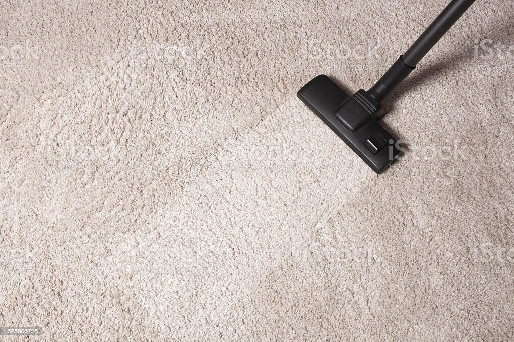 carpet dust cleaning with vacuum cleaner stock photo