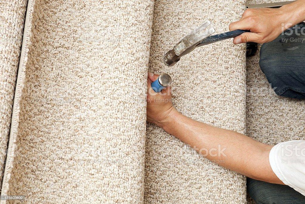 Carpet Installer Using Stair Tool stock photo