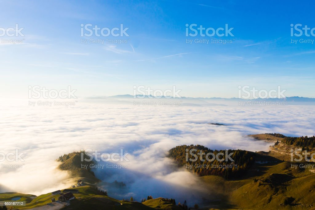 Carpet of clouds from mountain top stock photo