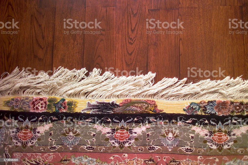 carpet on parquet royalty-free stock photo