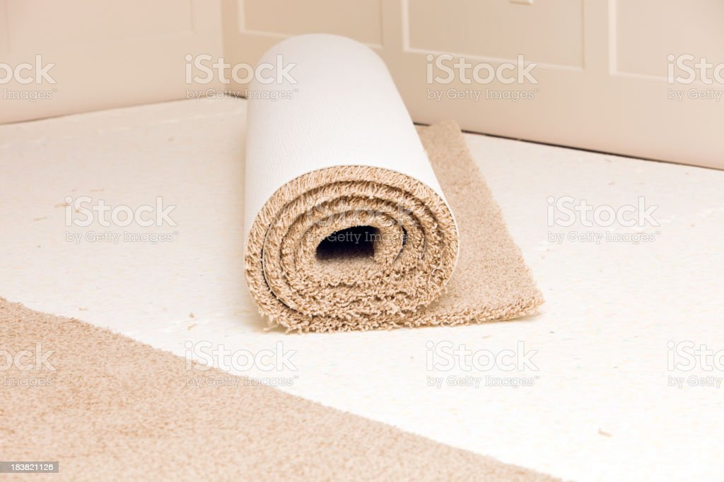 Carpet Roll on Pad in Bedroom Awaiting Installation stock photo