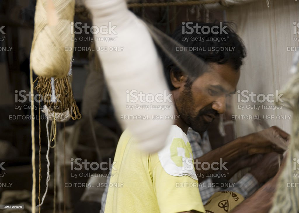 Carpet Weaver Working in the Shop stock photo