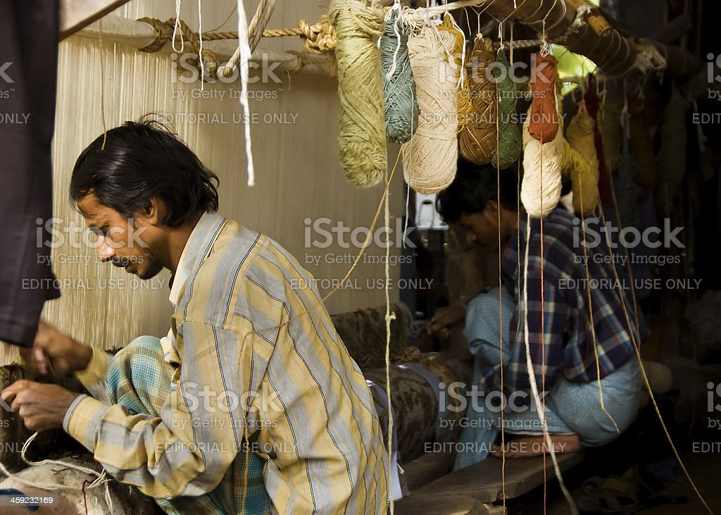 Carpet Weavers Working in the Shop stock photo