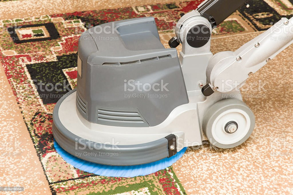 Carpets chemical cleaning with professionally disk machine. Early spring cleaning. stock photo