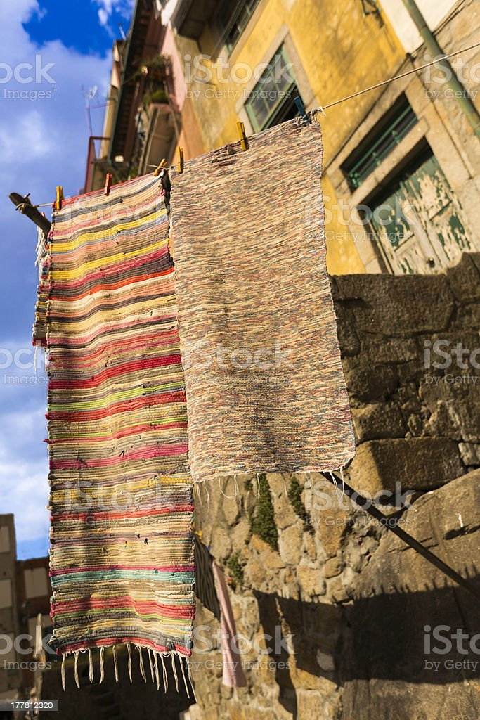 Carpets on linen rope in the city of Porto stock photo
