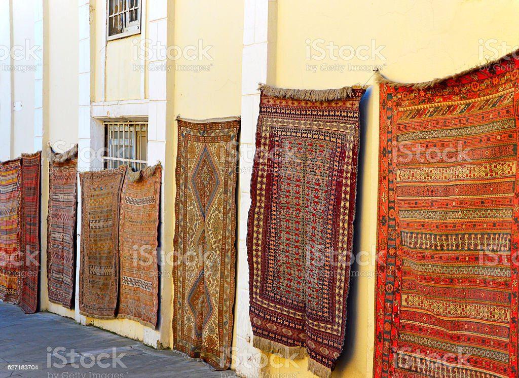 Carpets on the old street stock photo