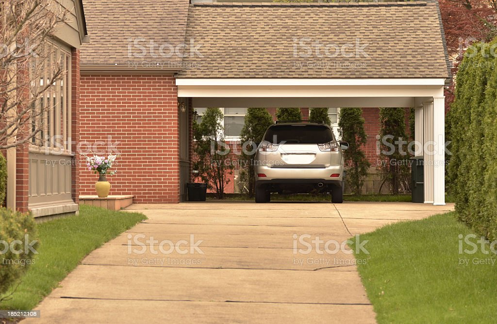 Carport with parked car and Nicely Maintained Grounds stock photo