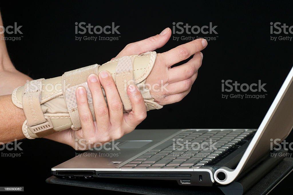 Carpul Tunnel in Wrist -  Using Laptop stock photo