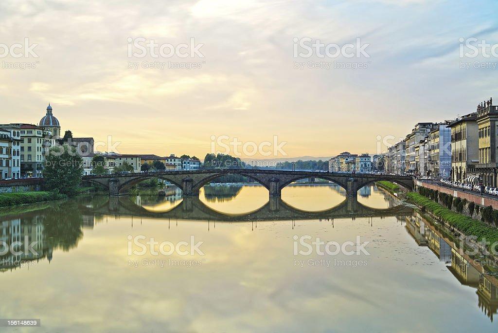 Carraia medieval Bridge on Arno river, sunset landscape. Florence, Italy. stock photo