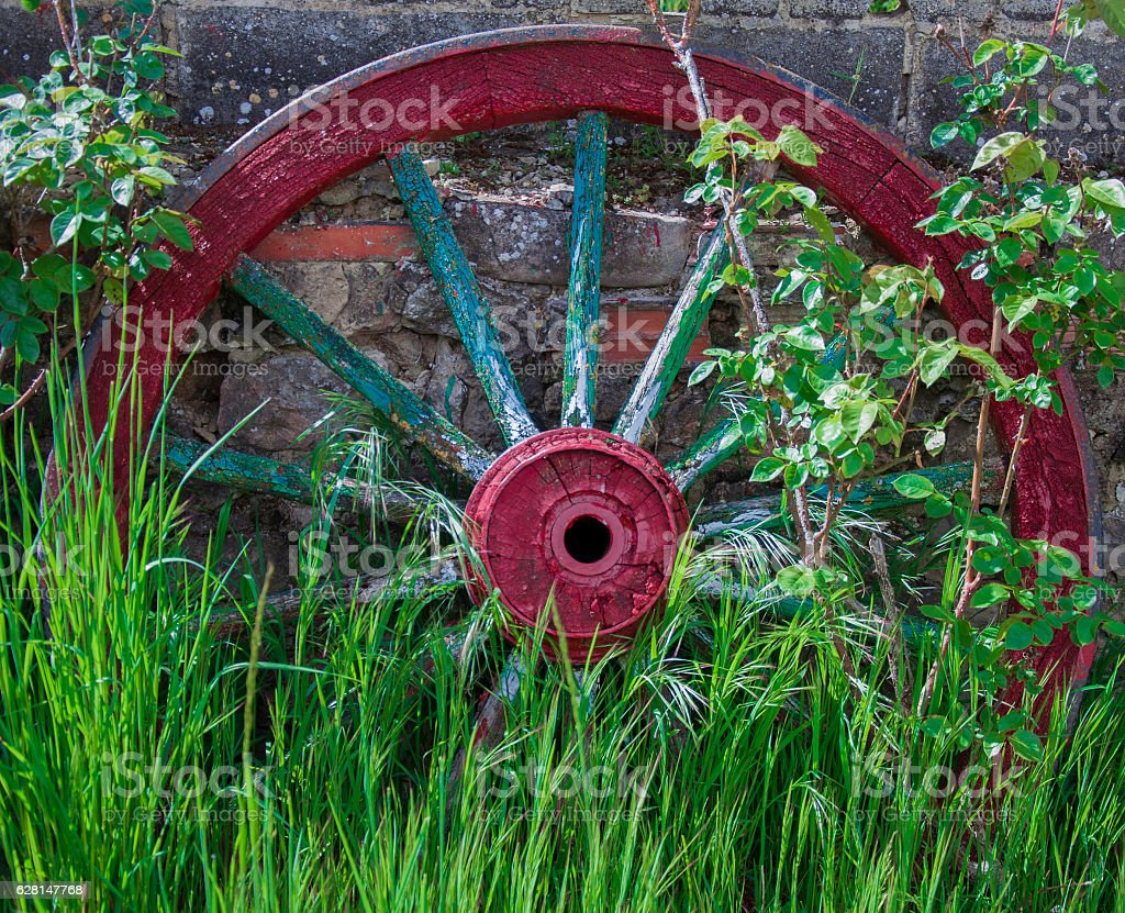Carriage wheel Abandoned in the countryside stock photo