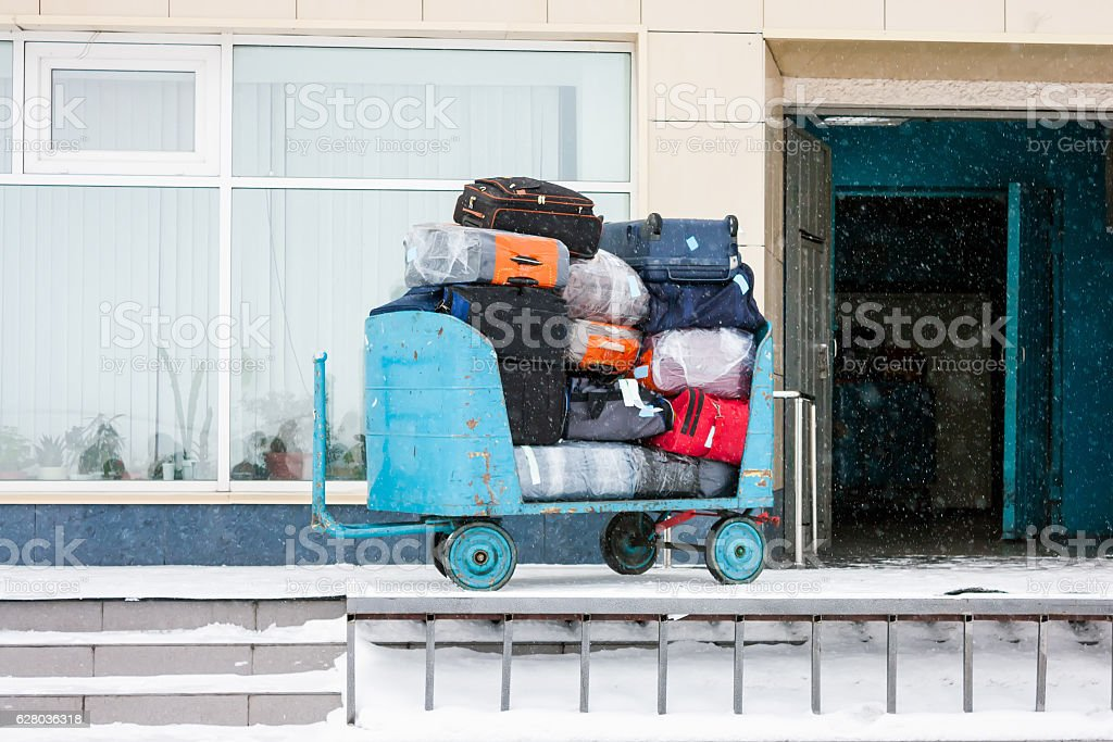 Carriage with luggage in winter airport royalty-free stock photo