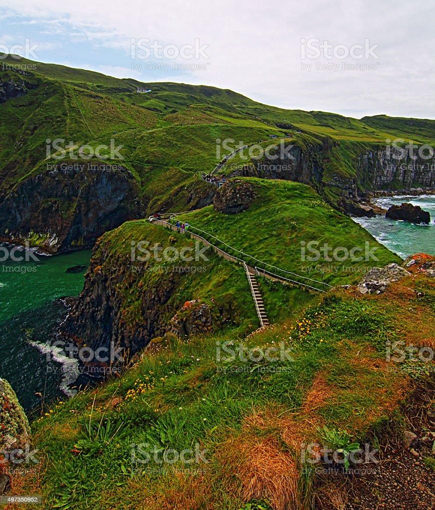 Carrick-a-Rede Irish Coastal Island with walking paths and suspension bridge stock photo