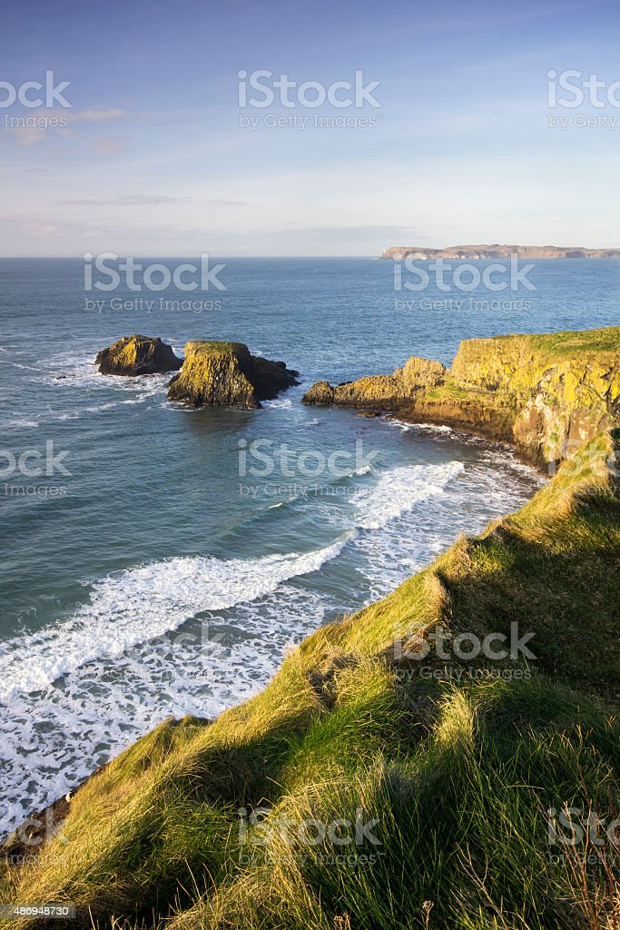 Carrick-a-Rede Rope bridge from the clifftops. stock photo