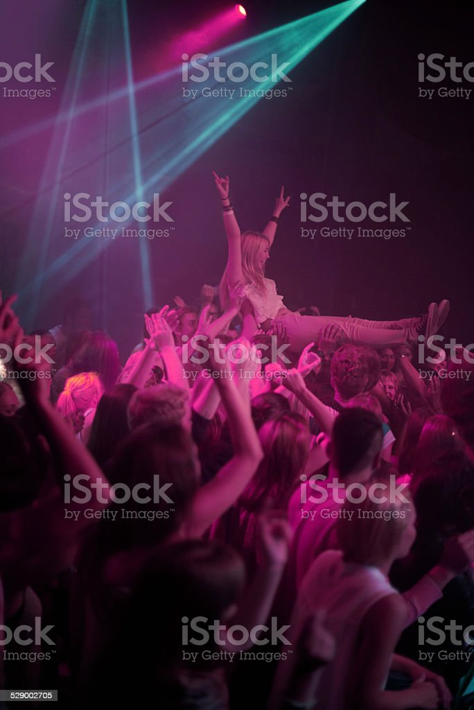 Carried by an awesome crowd! stock photo