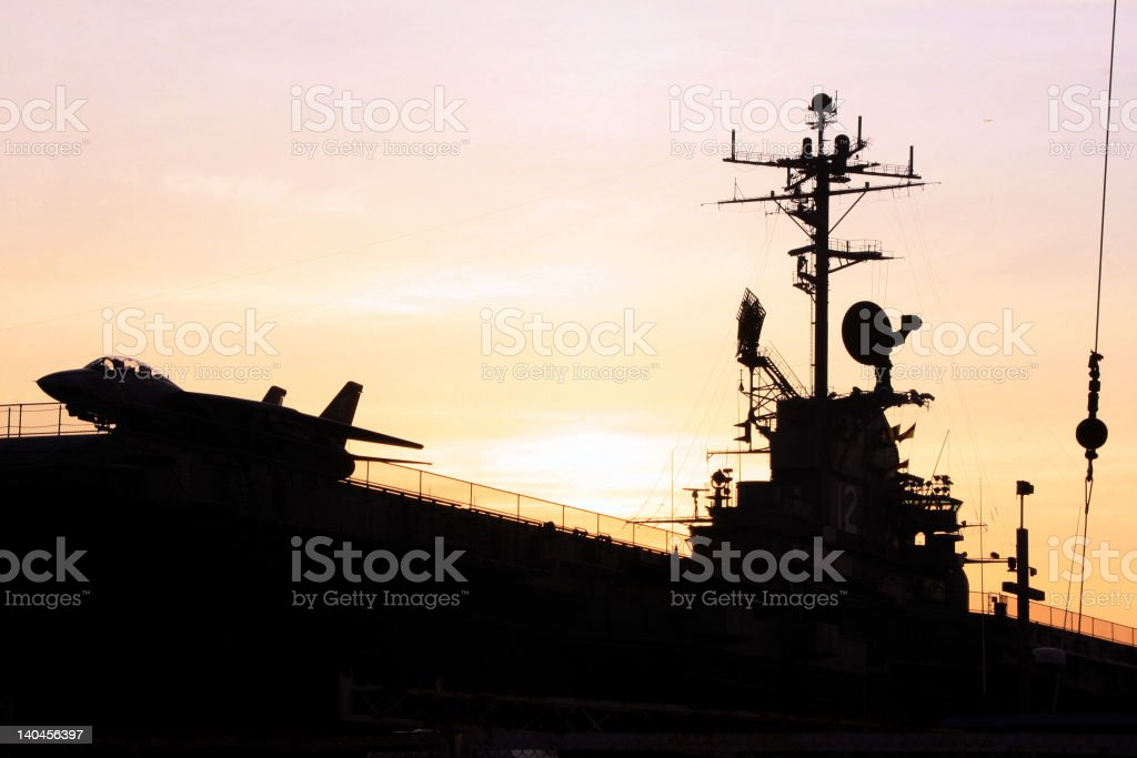 Carrier, Jet and Bridge Silhouette stock photo
