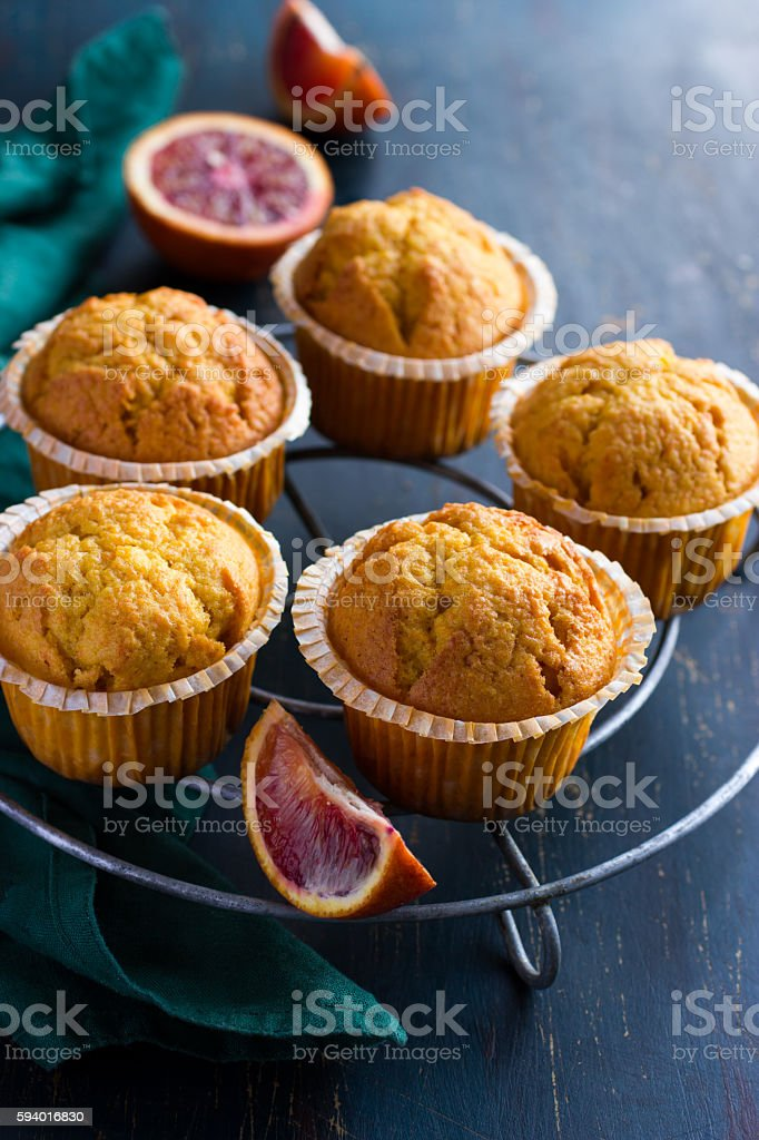 carrot and blood orange  muffins  on dark background stock photo