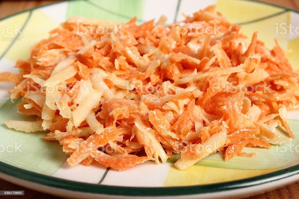 Carrot and celeriac salad with mayonnaise stock photo