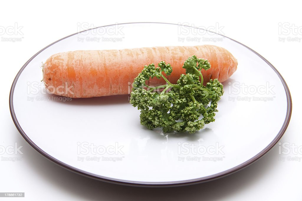 Carrot and parsley on plate stock photo