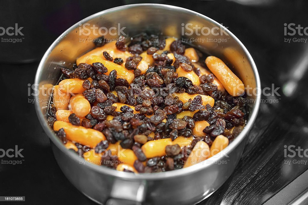 Carrot and raisins cooking for tzimmes royalty-free stock photo