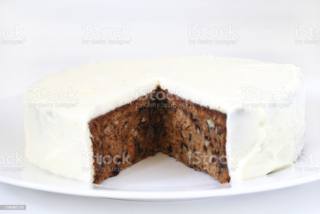 Carrot and walnut cake with marzipan icing stock photo