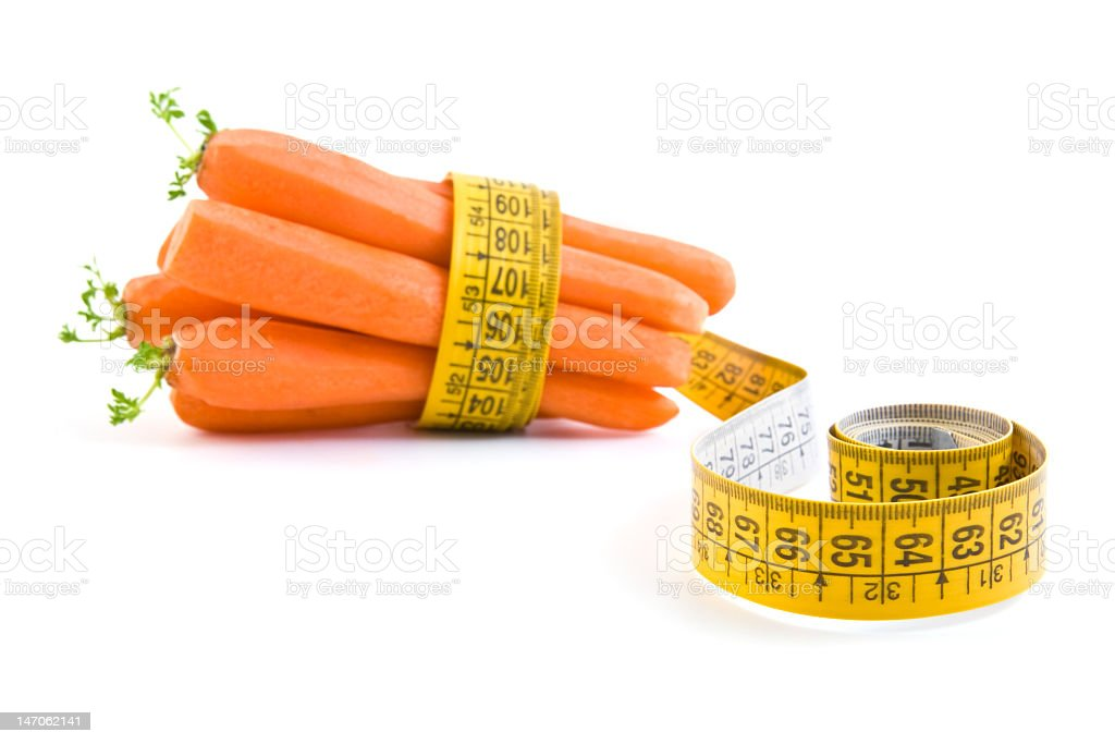 Carrot and yellow measuring tape royalty-free stock photo