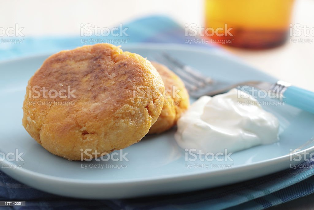 Carrot burgers with sour cream royalty-free stock photo