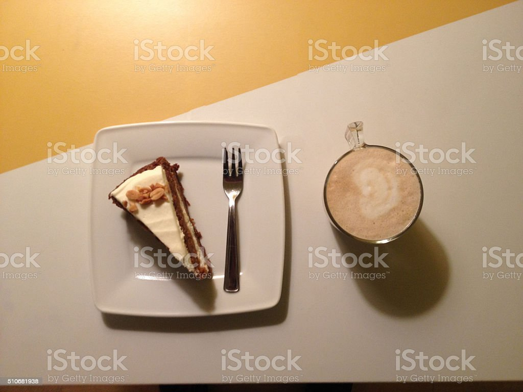 Carrot cake and Cappuccino stock photo