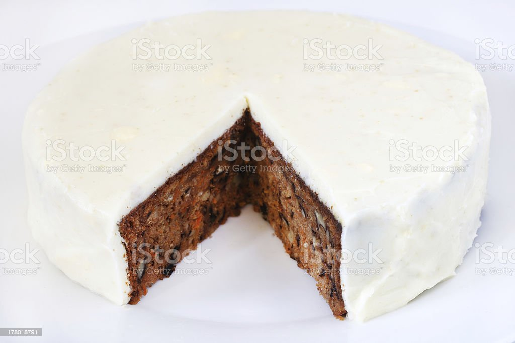 Carrot cake covered with marzipan and filled walnuts royalty-free stock photo
