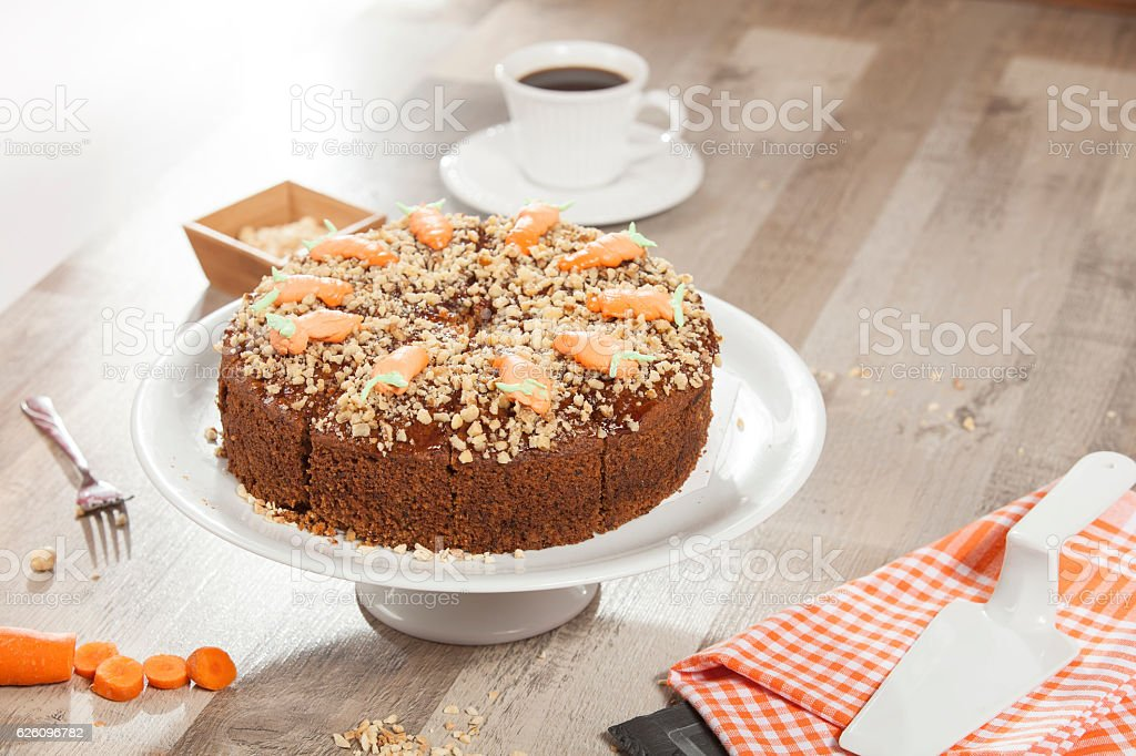 Carrot cake decorated with carrots on the top stock photo