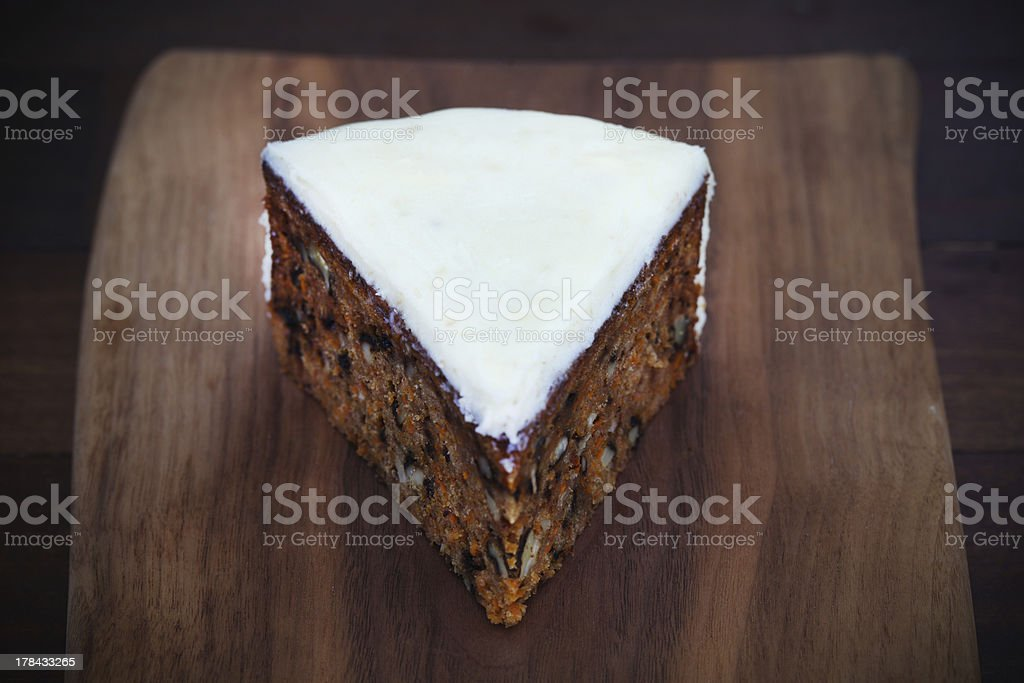Carrot cake piece with walnuts and cream cheese icing royalty-free stock photo