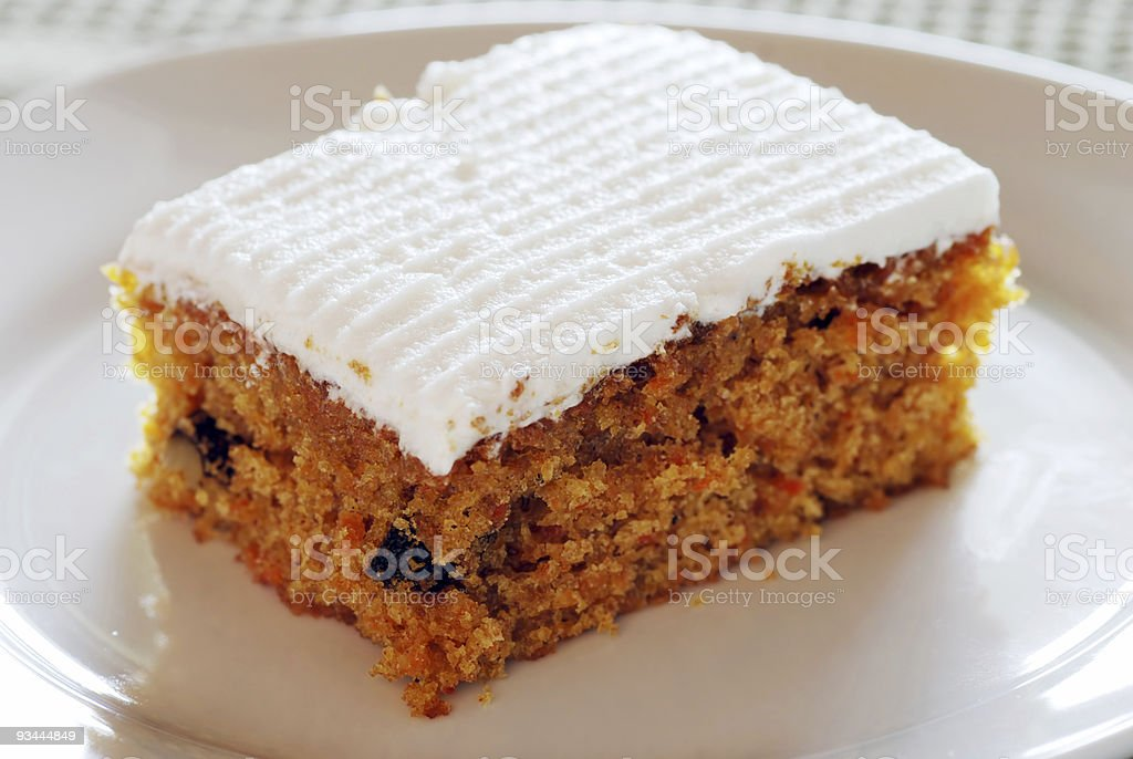 A carrot cake with vanilla icing stock photo