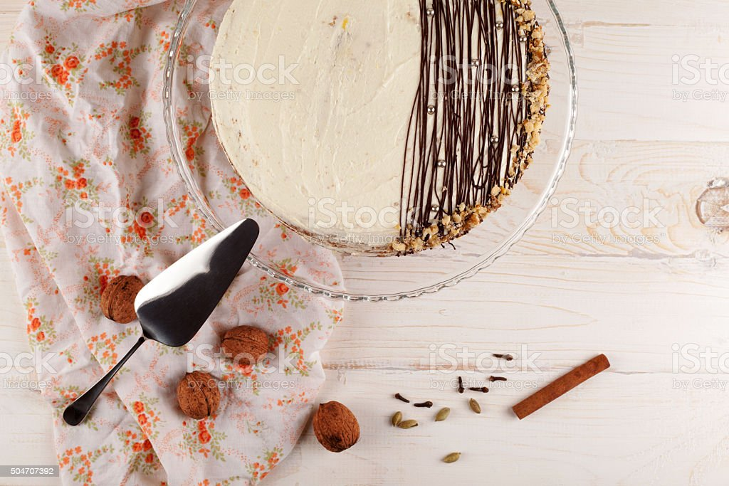 Carrot cake with walnuts and white cream. Top view. stock photo