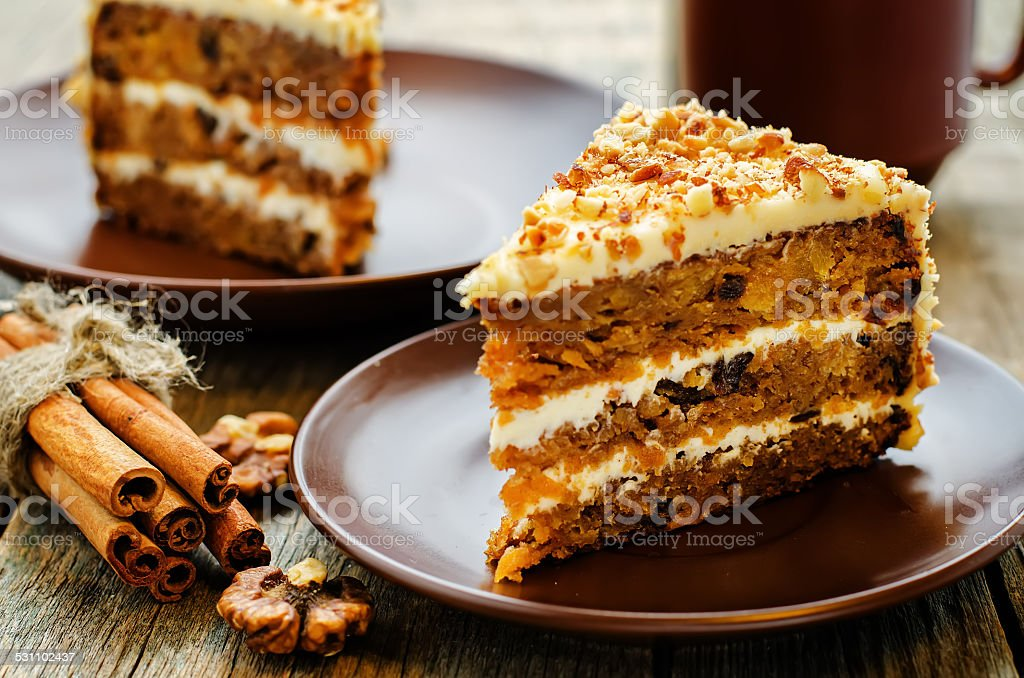 carrot cake with walnuts, prunes and dried apricots stock photo